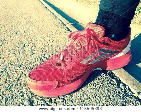 Cigarette End In Her Running Shoes