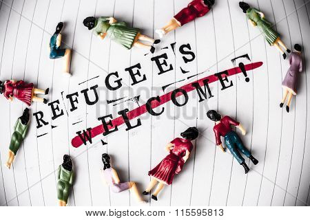 refugees welcome strikethrough text on white line paper with face off woman figures around