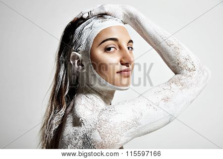Woman With A White Clay Body Skin Treatment