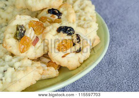 Homemade Fruitcake Cookies On Green Plate