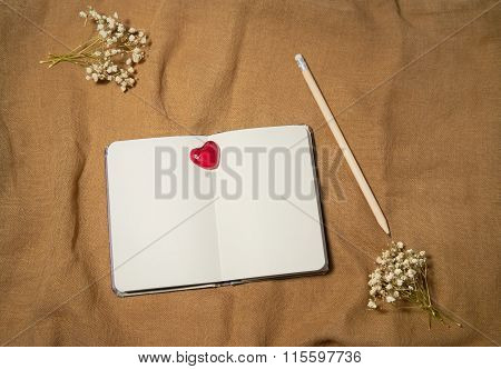 Blank Notebook With Heart On Sackcloth Background