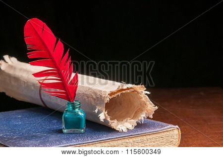 Quill pen and papyrus paper