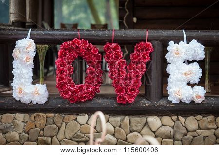 Original Romantic Valentyne Flower Sign The Word Love Spelled With White And Red Roses Closeup