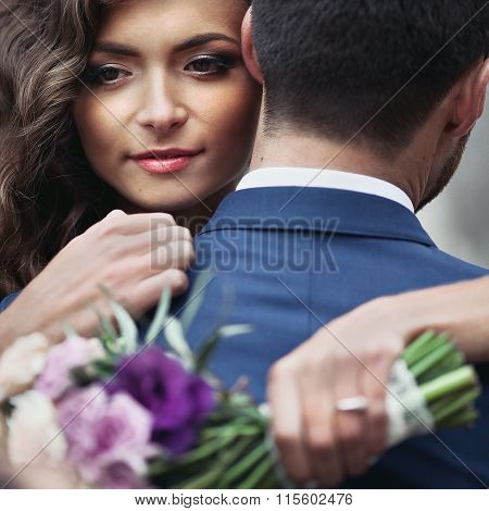 Beautiful Sensual Newlywed Bride Hugging Handsome Groom Face Closeup