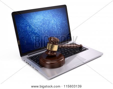 Law concept - Golden judge gavel on laptop