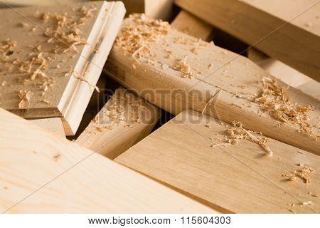 Wooden sticks lie on a workbench in the carpentry workshop