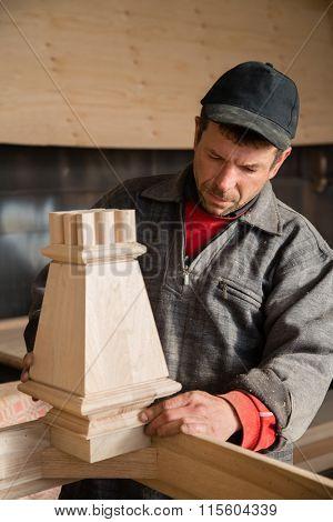 Carpenter controls make furniture in the carpentry workshop