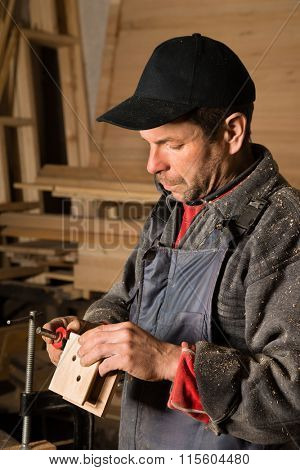 Carpenter makes the item of furniture made of wood.