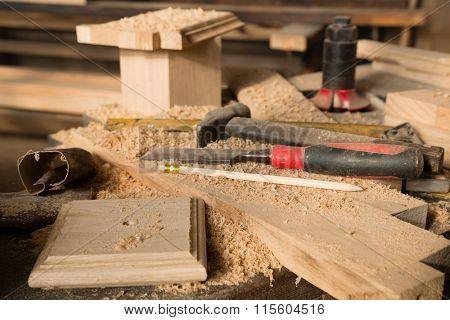 Hammer and chisel on the bench in the carpentry workshop