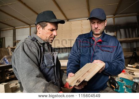 Inspector and carpenter and discuss the process of making wood products for furniture.