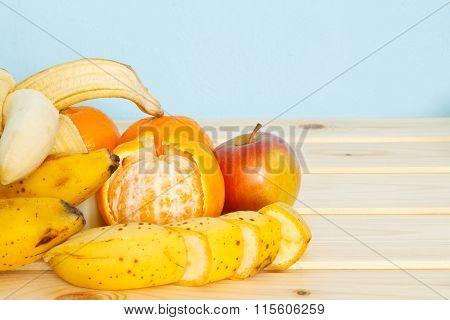 Apple, Bananas, Mandarines On Table