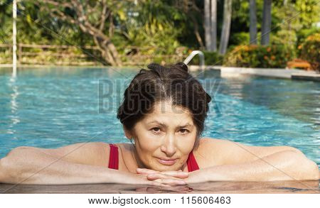 Portrait of woman bathing in the pool
