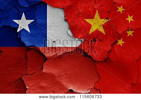 Flags Of Chile And China Painted On Cracked Wall