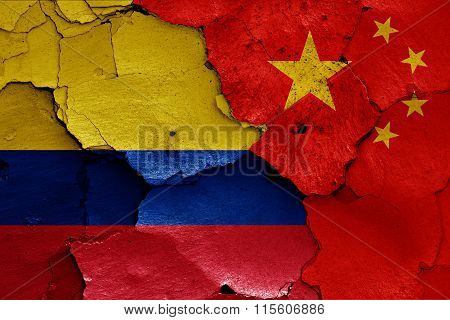 Flags Of Colombia And China Painted On Cracked Wall