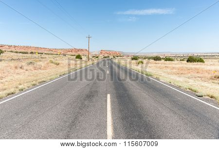 Long Straight Road Ahead Through Desert Of New Mexico, Usa.