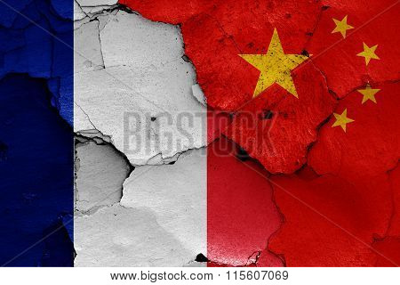 Flags Of France And China Painted On Cracked Wall