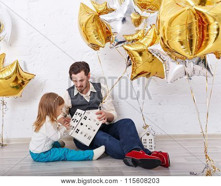 Father Plays With Daughter. Family Celebration.