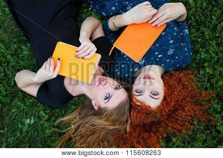 Best Friends Are Female Students Together On Lawn.