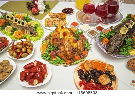 Lots of traditional festive food on table. Christmas table.