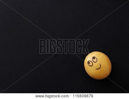 Art. Funny potato on a black background