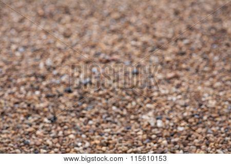 Defocus of Small stones in concrete footpath texture