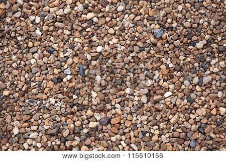 Small stones in concrete footpath texture