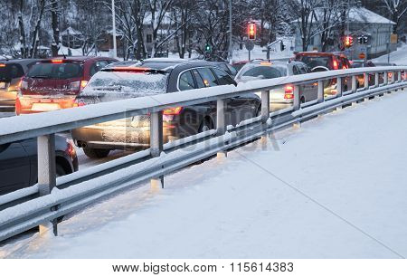 Cars In A Traffic Jam On Winter Street