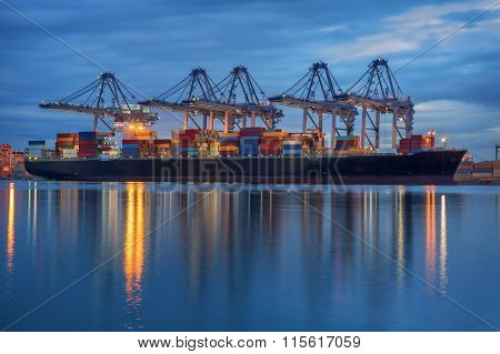 Container Cargo Freight Ship With Working Crane Loading