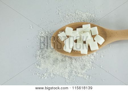 Sugar Cubes On Spoon With Granulated Sugar On Isolated White Background