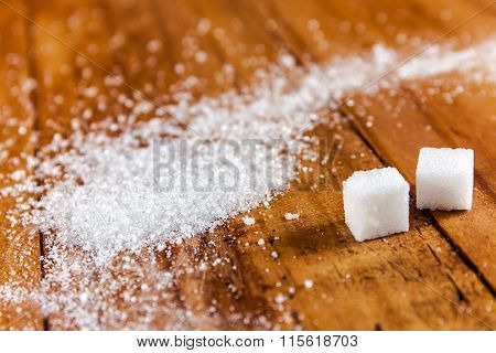 Granulated White Sugar Spill Over Wooden Background