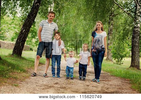 Family On Walk In Countryside