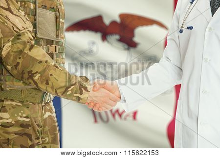 Military Man In Uniform And Doctor Shaking Hands With Us States Flags On Background - Iowa