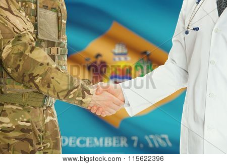 Military Man In Uniform And Doctor Shaking Hands With Us States Flags On Background - Delaware
