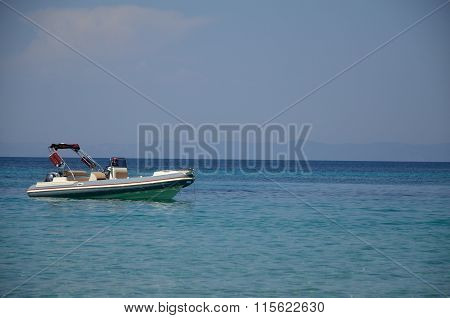 White Powerboat On Turquoise Sea