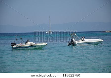 White Powerboats On Sea