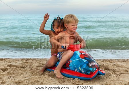 Ukraine Black Sea August 10, 2015: A Boy Playing On The Beach
