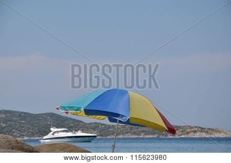 Powerboat And Sun Umbrella