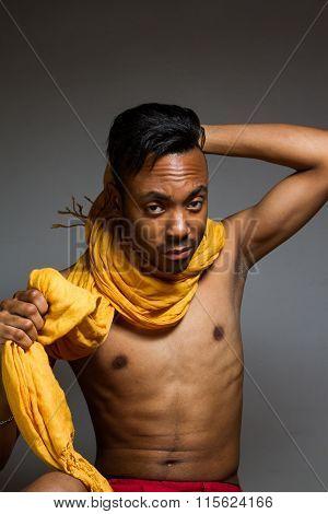 Latin Man Posing Indoor Over A Grey Wall.