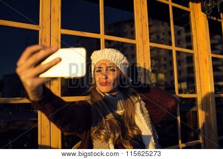 Young Woman Making Selfie On Her Phone