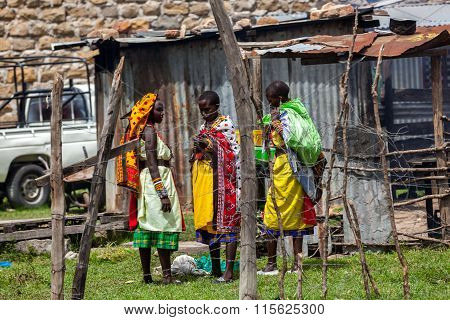 Masai Mara, Kenya - 02 January: The men and women of the tribe Masaya in national clothes January 2,