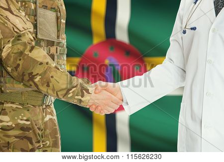 Military Man In Uniform And Doctor Shaking Hands With National Flag On Background - Dominica