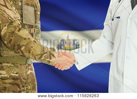 Military Man In Uniform And Doctor Shaking Hands With National Flag On Background - El Salvador