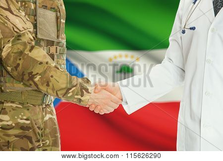 Military Man In Uniform And Doctor Shaking Hands With National Flag On Background - Equatorial Guine