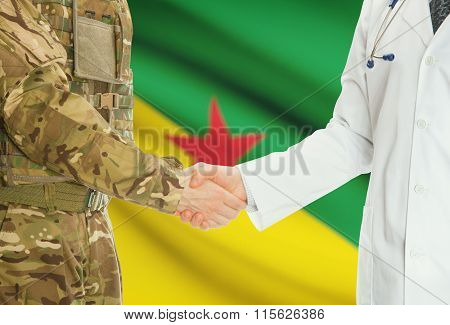 Military Man In Uniform And Doctor Shaking Hands With National Flag On Background - French Guiana