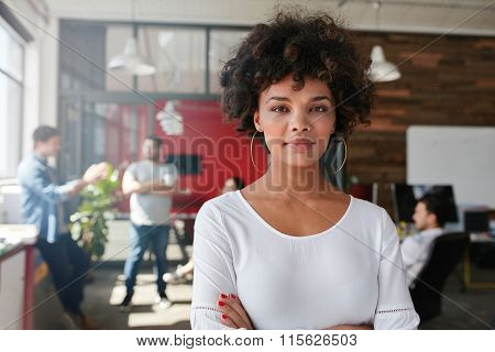 Woman Standing In Busy Creative Office