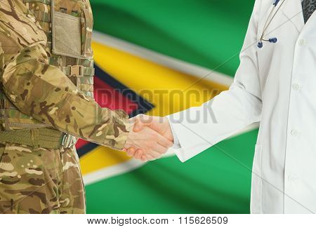Military Man In Uniform And Doctor Shaking Hands With National Flag On Background - Guyana