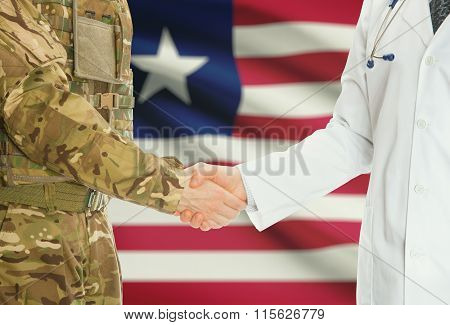 Military Man In Uniform And Doctor Shaking Hands With National Flag On Background - Liberia