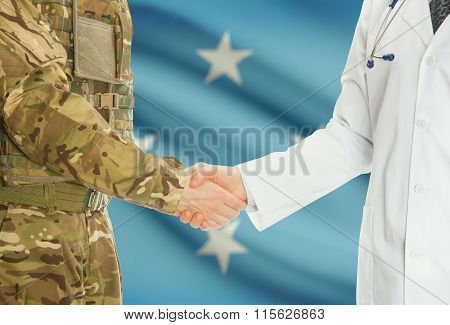Military Man In Uniform And Doctor Shaking Hands With National Flag On Background - Micronesia
