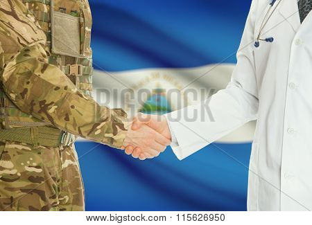 Military Man In Uniform And Doctor Shaking Hands With National Flag On Background - Nicaragua