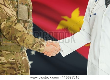 Military Man In Uniform And Doctor Shaking Hands With National Flag On Background - Papua New Guinea